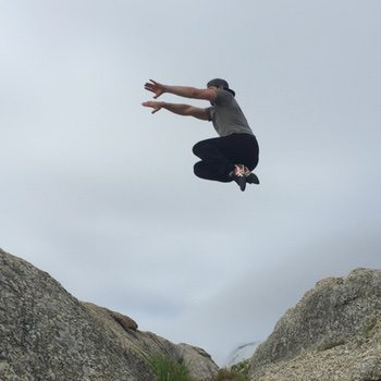 Ryan jumping over a cliff