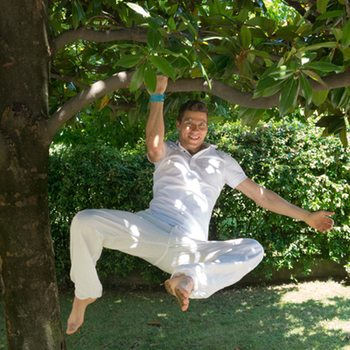 Sami hanging one-handed from a tree branch