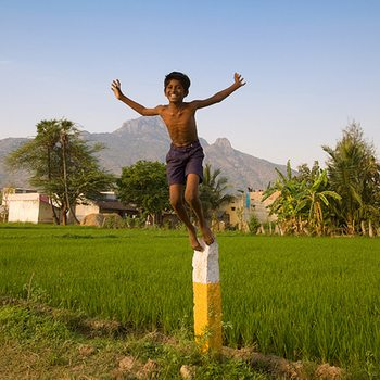 Young boy jumping from a pedestal