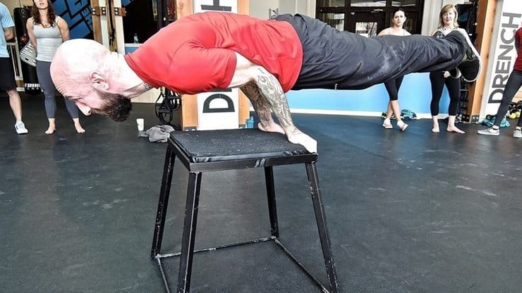Al Kavadlo doing a double arm lever