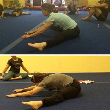 Reney performing a pancake stretch technique