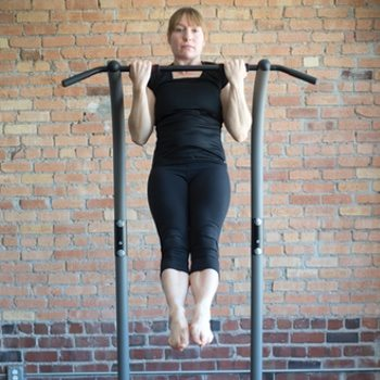 Kirsty performs pull-ups on a bar