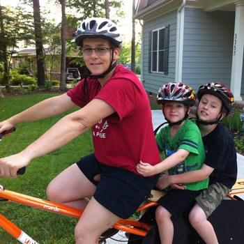 Amy cycling with her family