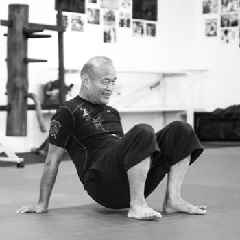 Guro Dan Inosanto performing a squat technique
