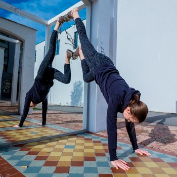 Performing a handstand walk against a mirror