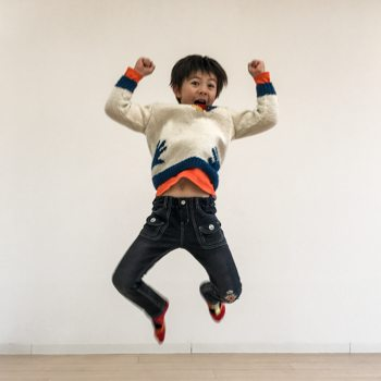Ryan's son jumping in the air