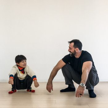 Ryan Hurst teaching his son how to do a squat technique
