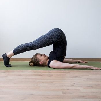 Plow pose stretch for flexibility