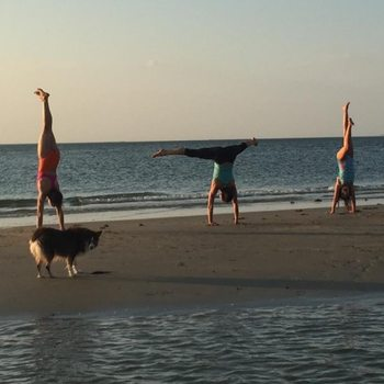 Handstands on beach
