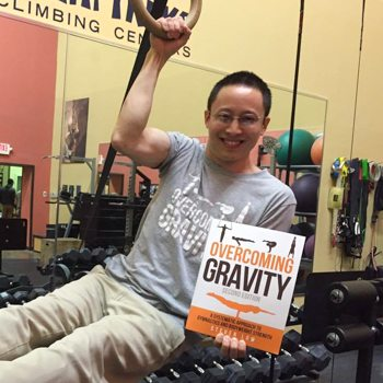 holding overcoming gravity book in gym