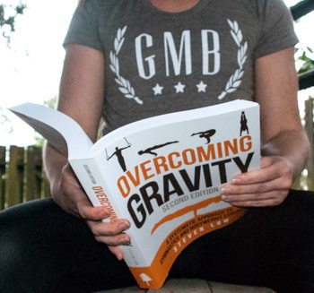 person reading overcoming gravity book