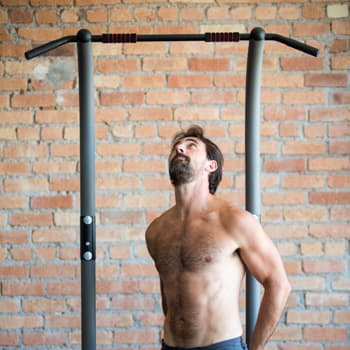 Ryan preparing to exercise on a pullup bar