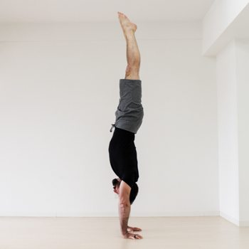 Ryan Hurst practicing a perfect handstand