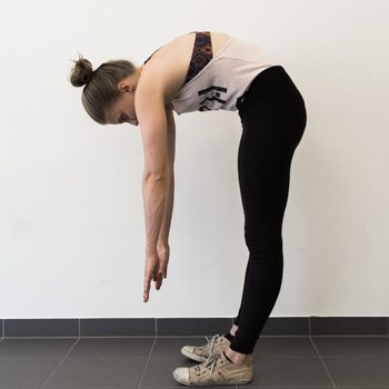 Alicia performing a forward fold stretch
