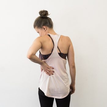 Alicia pointing to areas common for back pain