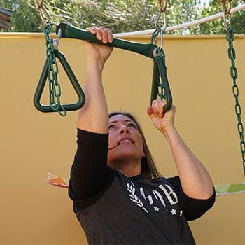 Stacey doing a pull up exercise