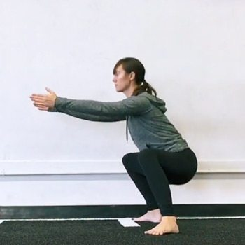Rose performing a squat for hip pain