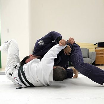 athletes grappling in Brazilian Jiu Jitsu