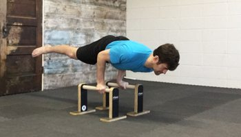 Practicing a Bodyweight Arm Lever on Parallettes