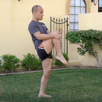 Jarlo doing standing knee to chest exercise