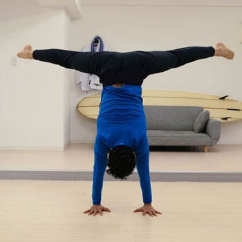 Chris doing a straddle handstand exercise