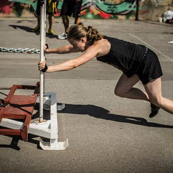 Alicia pushing weight sled