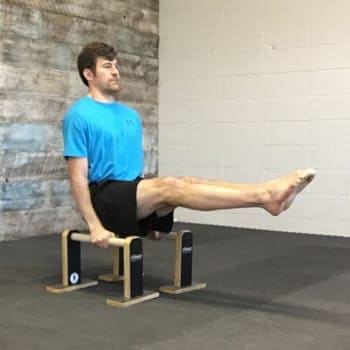 Jeff doing L-sit exercise on parallettes