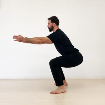 Ryan doing a squat exercise