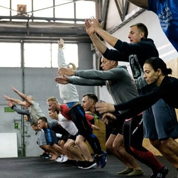 Group class doing broad jumps