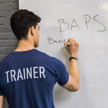 GMB Trainer Chris writing on whiteboard