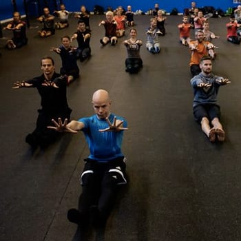 Group class showing stretching exercise