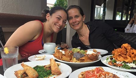 Two women enjoying a delicious meal