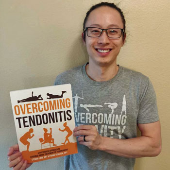 Steven Low holding a copy of Overcoming Tendonitis