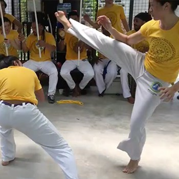 Michelle Ho practicing capoeira