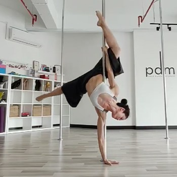 Michelle Ho practicing pole dancing