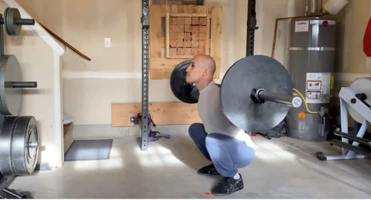 Jarlo doing the barbell Olympic squat