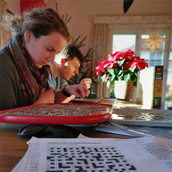 Beth doing a puzzle